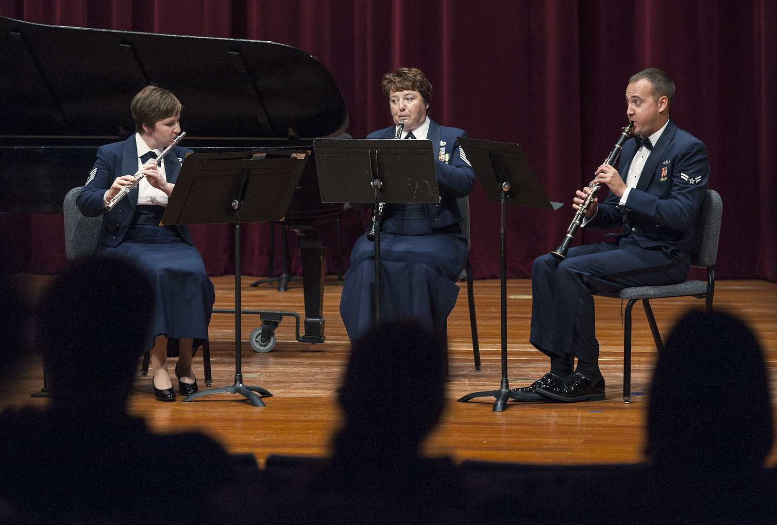 Technical Sergeant Elizabeth Honaker (Flute), Master Sergeant Coreen Levin (Oboe) and Airman First Class Brian Wilmer (Clarinet) play Divertimento for Flute, Oboe and Clarinet, Op. 37 by Sir Malcolm Arnold at a performance by The United States Air Force Band of the Golden West in Knuth Hall. Friday, September 27, 2013. Photo by Benjamin Kamps / Xpress