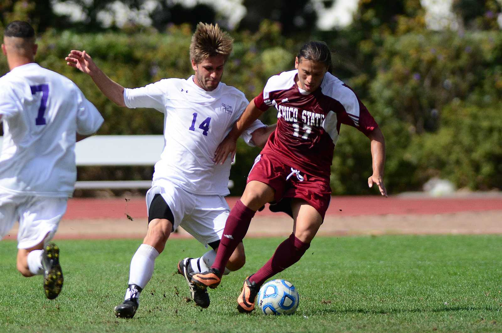 Nathan Fernandez (14) pursues the ball alongside Octavio Guzman (17) during a game against Chico State at Cox Stadium, Oct. 6, 2013. The Gators lost the game 0-1. Photo by Philip Houston / Xpress