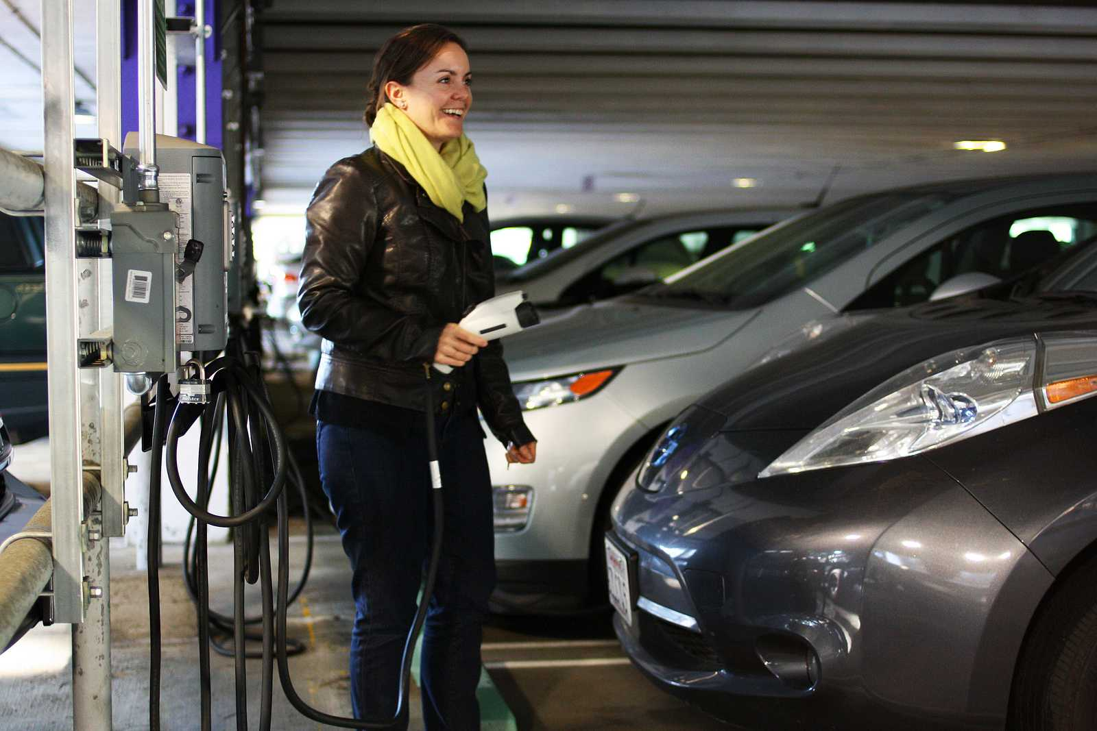 Kinesiology professor Marcia Abbott unplugs her car from the free electric charging stations on the first floor of the parking lot, located near the elevator Oct. 10, 2013. Photo By Tony Santos / Xpress