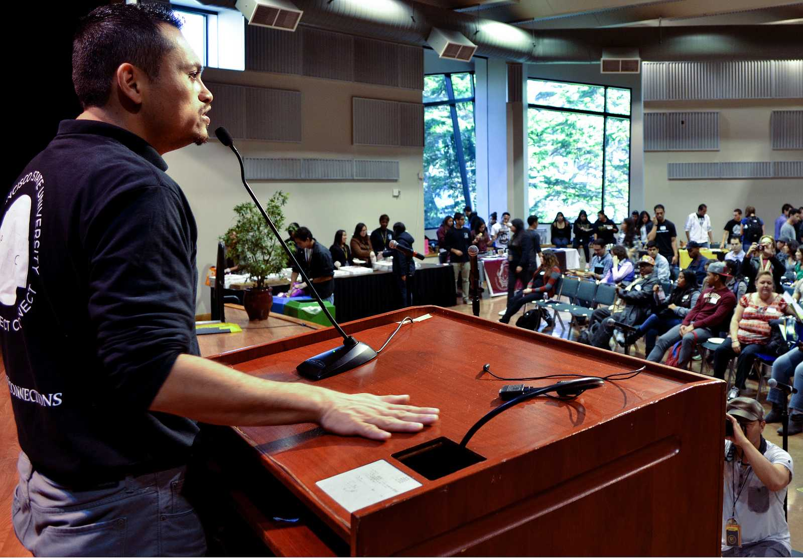 Mario Flores, the director of ASI's(Associated Students, Inc.) Project Connect speaks to students about the day's workshops held to help inform them about transferring to SF State, at the main event held in Jack Adams Hall, Wednesday, Nov. 6, 2013. Students came from different community colleges around the Bay Area to visit SF State for Transfer Day.  Photo by Amanda Peterson / Xpress