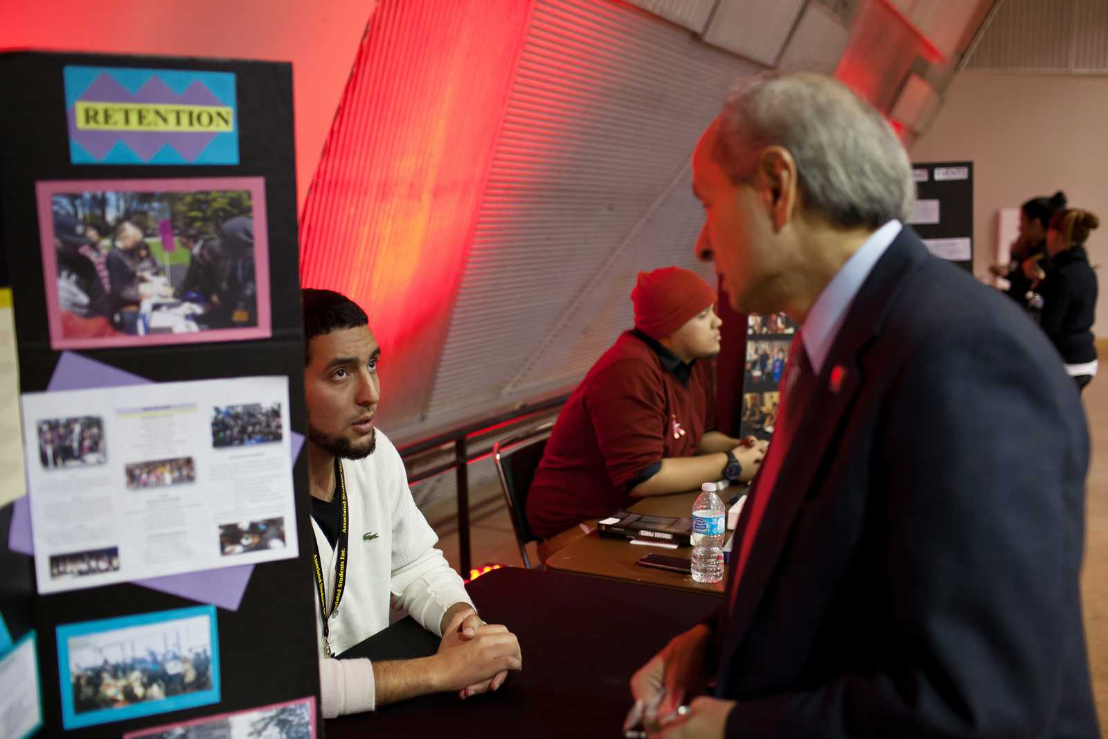 Issa Ibrahim, business major with ASI Project Connect, discusses scholarships with President Leslie E. Wong at the World AIDS Day event at SF State on Tuesday, Dec. 3 2013. The event is part of a global effort to increase awareness which occurs annually on the first of December. Photo by Dariel Medina / Xpress