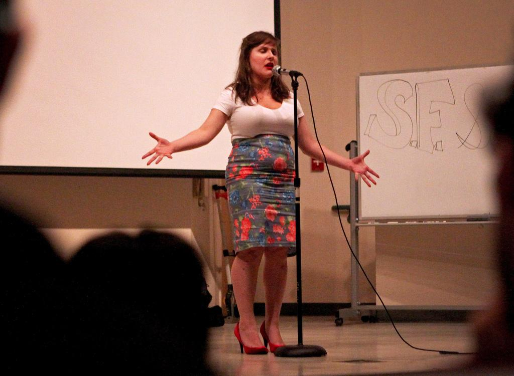 "S.P.E.A.K. SFSU's Becky Raeta performs ""To My Father"" during the Battle of the Bay Poetry Slam  in the Humanities Auditorium Friday, Feb. 28."