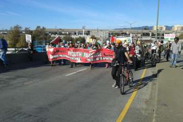 Pro-Palestinian protestors march along 7th Street toward the Oakland shipyard in an effort to block Israeli cargo company Zim Integrated Shipping Services Ltd. Sunday, Oct. 26, 2014.