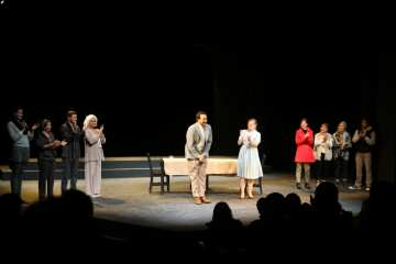 """Lo Prentiss, playing Jean, and Jacob Hsieh, playing Dwight, bows after """"Dead Man's Cellphone"""", a comedy by Sarah Ruhl, Tuesday, Oct. 21, 2014 in the Little Theater."""