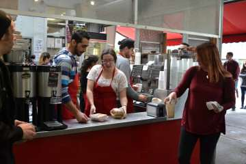 Cafe Rosso employees (Left to right) Oday Alsalni, hospitality and tourism major Ally Walker and Qaed Hammad hustle to serve the SF State lunch time rush Tuesday, Nov. 18, 2014. Helen Tinna/Xpress.