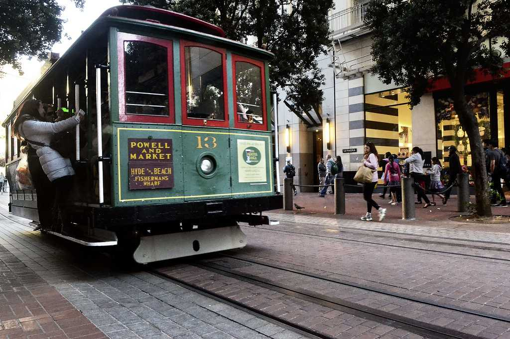 Tourists hop onto the trolley at Powell and Market Streets on Saturday, May 18, 2013 and head over to Fisherman's Wharf, a popular destination point in San Francisco. Photo by Jessica Worthington / Xpress