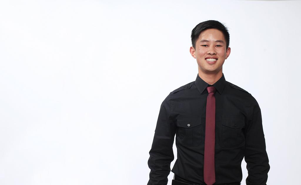 Jacky Chow, a senior criminal justice major, dressed in his job interview attire on Monday, May 20, 2013. Photo by Mike Hendrickson / Xpress
