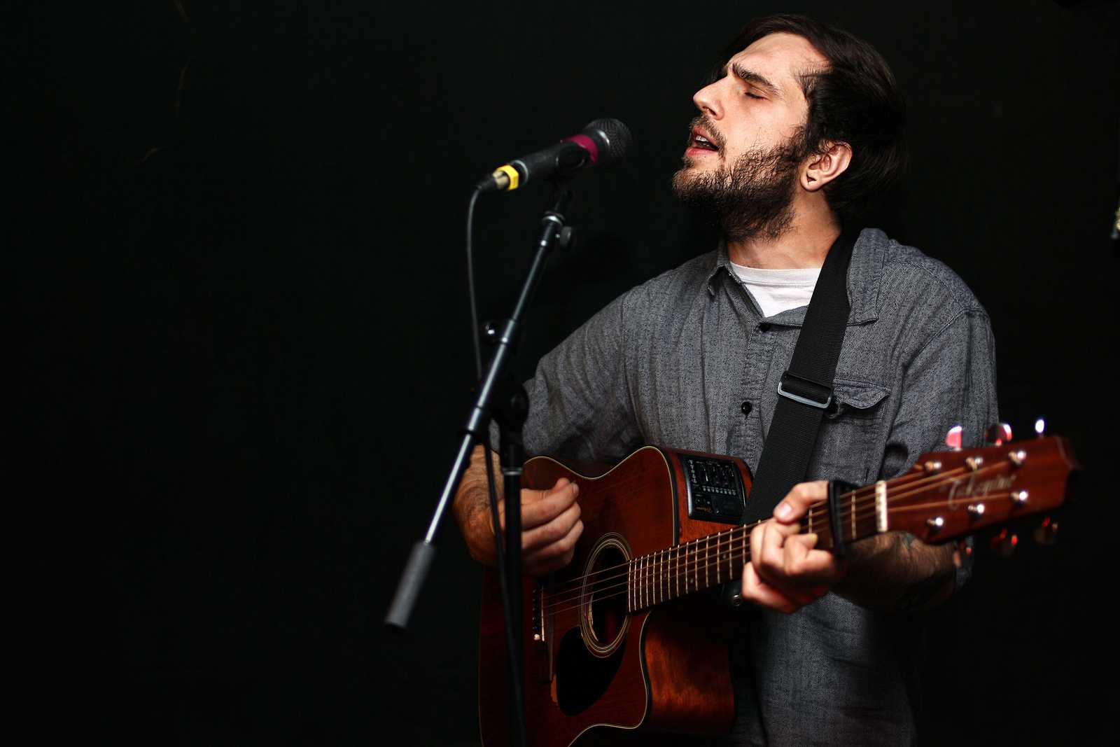 Derek Schultz of Owl Paws performs solo at The Depot's Strung Out acoustic show Wednesday, Oct. 23, 2013. Photo by Tony Santos / Xpress