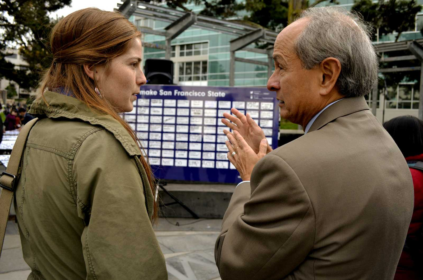 Kaitlyn Cornell (left) a 21-year-old drama and political science major, talks with President Leslie E. Wong in Malcolm X Plaza during the Strategic Plan event Monday, Nov. 18, 2013. Students expressed their ideas and shared what they thought would make SF State a better place. Photo by Amanda Peterson / Xpress