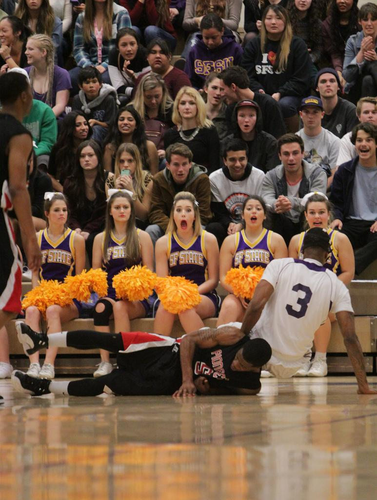 SF State Gator (3) and CSU East Bay (5) fall to the ground attempting to grab the ball. The Crowd in the background gasps as CSU East Bay and SF State battle it out Friday February 28. Photo by Erica Marquez / Special to Xpress.