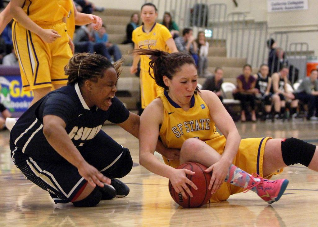 SF State's Angela Van Sickel (3) wrestles Cal State Monterey Bay's Angelique Bailey (33) for the ball during a home game against the Otters Saturday, March 1. The Gators won the game 66 to 47. Photo by Gavin McIntyre / Xpress