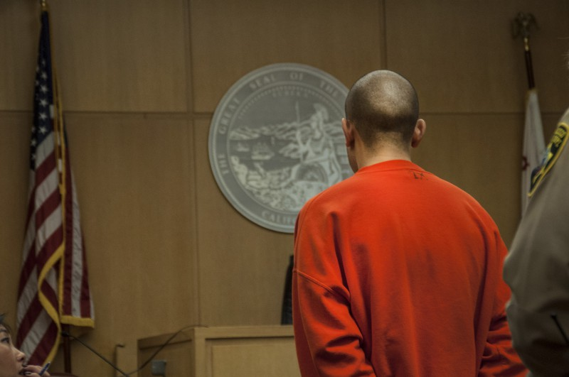 Nikhom Thephakaysone stands in front of Judge Tracie Brown in the San Francisco Superior Court's Hall of Justice during a court hearing Thursday, March 27. Thephakaysone is facing felony counts that include assault with a deadly weapon, posession of an illegal firearm and the murder of Justin Valdez. Photo by Jessica Christian / Xpress